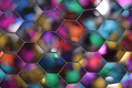 Colorful bokeh background photographed through a honeycomb grid diffuser Stock Photo