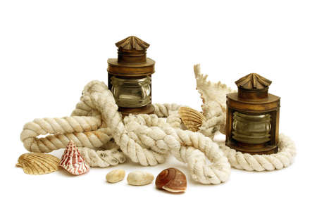 Arrangement of two marine lanterns, thick ropes and shells isolated on white background Stok Fotoğraf