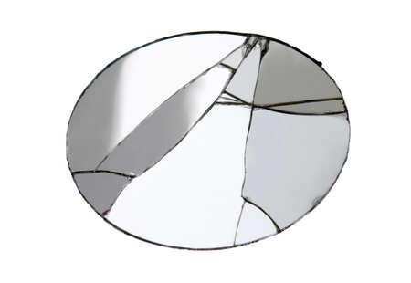 Oval broken mirror isolated on white background. Studio shot