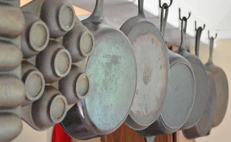 Cast Iron Pans hanging in a row