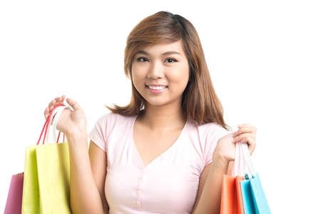 shoppingbag: Portrait of cheerful girl with purchases