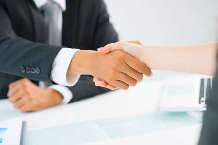 concluding: Partners shaking hands to demonstrate mutual respect