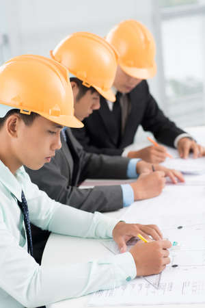 Row of architect being busy projecting Stock Photo