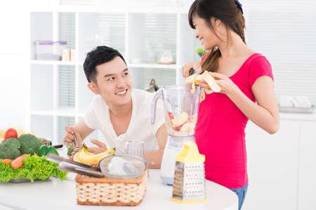 fruit mix: Girl preparing fruit mix for her boyfriend