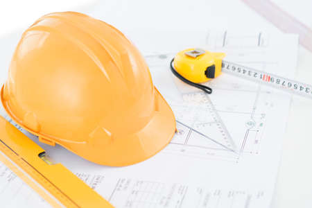Image of a typical engineer workplace with blueprint, hardhat and measuring tools Stockfoto