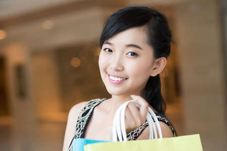 Portrait of a girl smiling at camera in the store