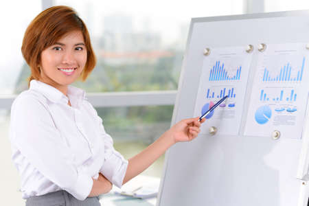 lovely businesswoman: Portrait of a lovely young businesswoman presenting her project on board
