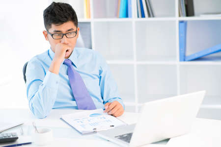 Image of a young sales manager worrying about risky strategic movement  Stock Photo