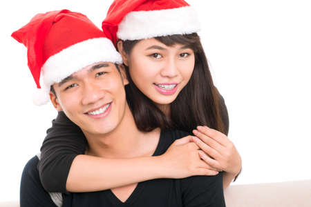 Close-up image of a couple wearing Santa caps and preparing for Christmas Stock Photo