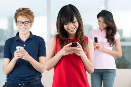 tons: Friends sending tons of sms to each other to keep in touch Stock Photo