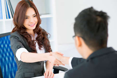 concluding: Young businesspeople concluding a deal and sealing it with a handshake Stock Photo