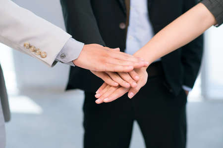 trust people: Business people putting their hands together in sign of trust and unity