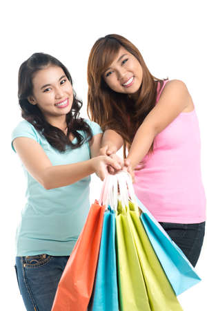 boasting: Cheerful girlfriends showing their bags