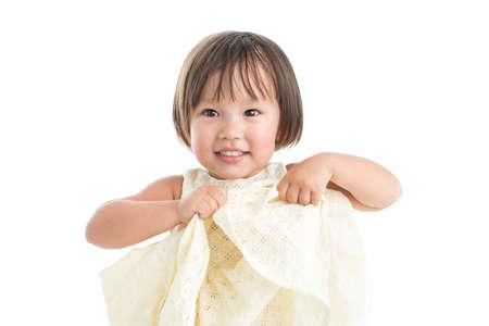 boasting: Little girl boasting of her new dress Stock Photo