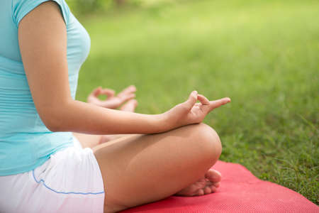 Young female meditating to concentrate vital energy