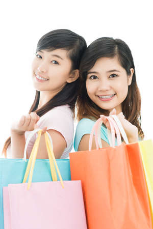 boasting: Vertical image of charming shoppers posing with their purchases