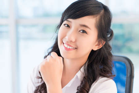 Close-up portrait of a businesswoman with confident look and pleasant smile