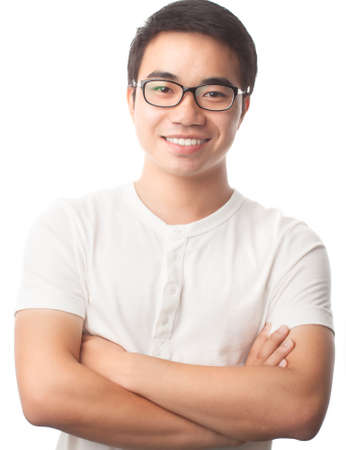 confidently: Vertical shot of a smart Vietnamese guy with his arms crossed confidently isolated on the white