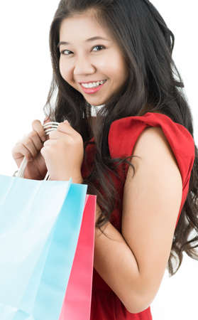 shoppingbag: Portrait of a young woman holding shopping bags Stock Photo