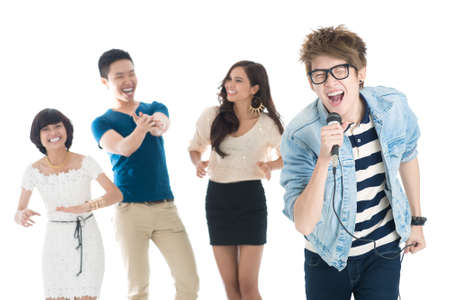cool guy: Cool guy singing karaoke, his friends enjoying Stock Photo