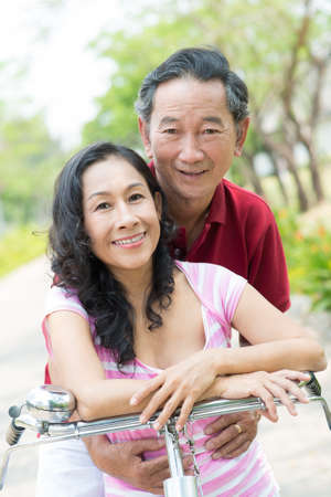 Portrait of a senior couple embracing in the park together