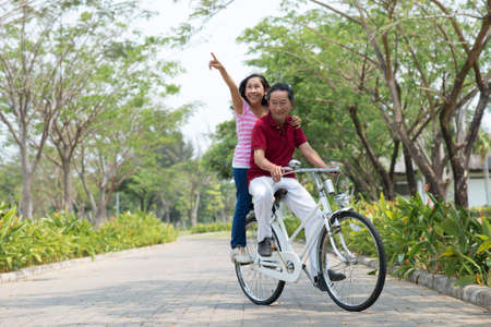 Senior couple bicycling together in the park