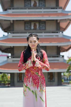eyesclosed: Vertical image of a buddhist praying woman outside Stock Photo