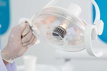 dentalcare: Close-up image of an adjustable dental lamp