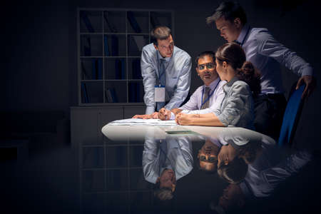 team working: Copy-spaced image of a modern business team working in the night before deadline