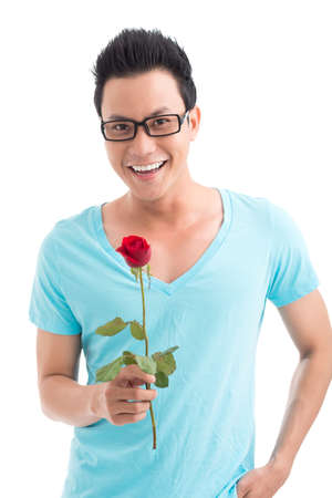Vertical portrait of a young man with a red rose in hand over a white background Stock Photo