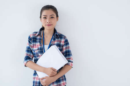 Isolated portrait of a young lovely businesswoman in casual with paper in hands