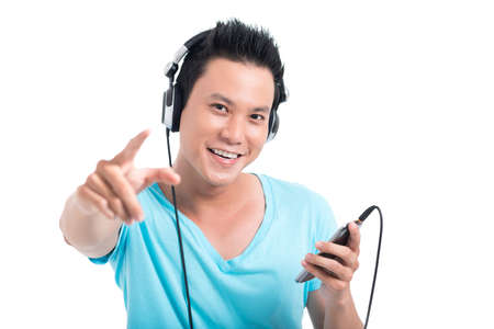 Isolated portrait of a young cool teen listening to the music