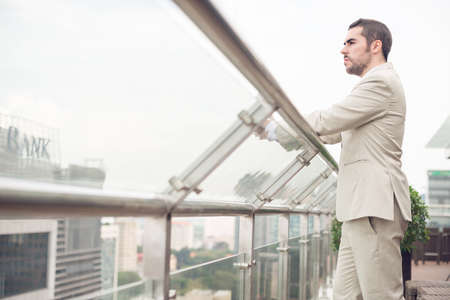 ambitious: Copy-spaced image of a young ambitious businessman standing outdoors