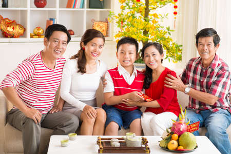 Portrait of a big Asian family celebrating the Chinese New Year together at home  Stock Photo