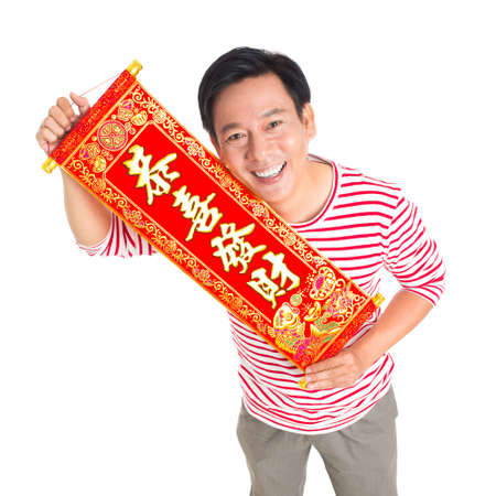 Isolated portrait of a man holding Tet textile with congratulations against a white background