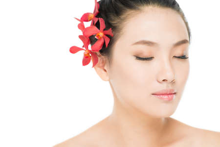 Image of an eye-closed Asian beauty with smooth skin and natural make-up