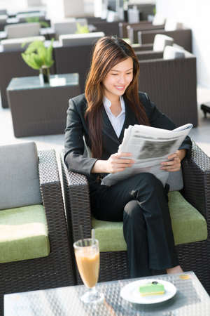 asian businesswoman: Vertical image of a business woman enjoying her free time Stock Photo