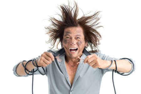 Man holding bared wires and screaming of pain  Stock Photo