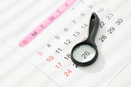 important date: Close-up image of a calendar with a glass magnifying the most important date Stock Photo