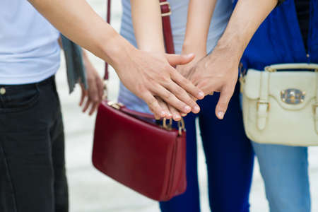 handclasp: Close-up of people pile hands