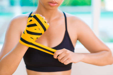 taping: Close-up image of a tough girl taping her hand