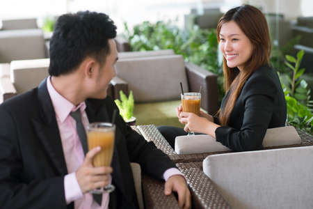 formalwear: Young people in formalwear flirting in the cafe Stock Photo