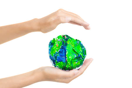 massy: Paper-planet in hand Stock Photo