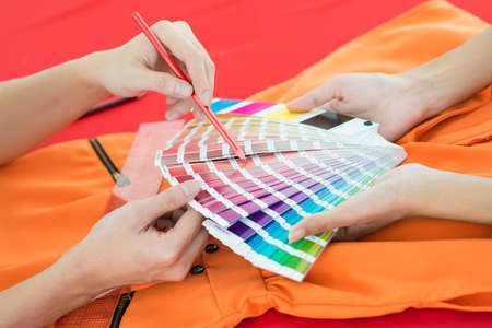 Two people choosing the color from the spectrum Stock Photo