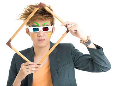 Asian boy holding frame