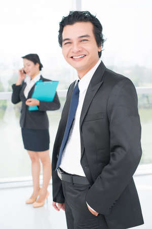 ambitious: Vertical portrait of an ambitious entrepreneur smiling with enthusiasm