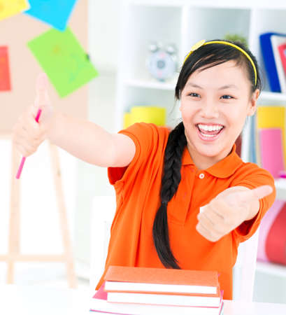 Portrait of a student smiling and thumbing up Stock Photo