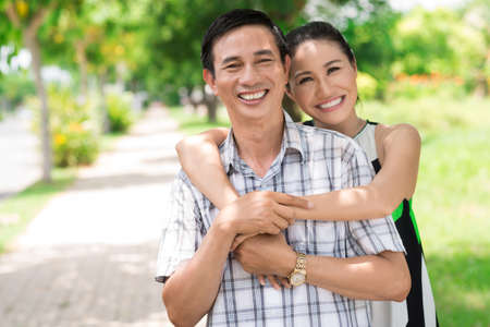 Close-up of a smiling couple in the park
