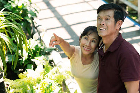 landlady: Close-up of a mature couple, a woman pointing at something