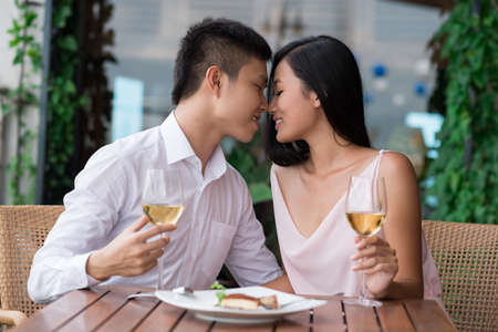 Image of amorous young people on a date being about to kiss